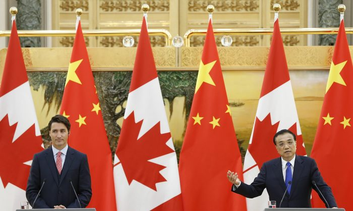 BEIJING, CHINA - AUGUST 31:  Canadian Prime Minister Justin Trudeau (L) with Chinese Premier Li Keqiang addresses a press conference at the Great Hall of the People on August 31, 2016 in Beijing, China. At the invitation of Premier Li Keqiang of the State Council of China, Prime Minister of Canada, Justin Trudeau will pay an official visit to China from Aug 31 to Sep 6.  (Photo by Lintao Zhang/Getty Images)