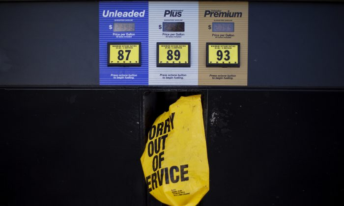 A gas pump is covered with a plastic bag   (AP Photo/David Goldman)