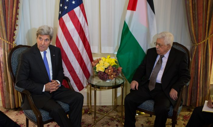 U.S. Secretary of State John Kerry talks with Palestinian President Mahmoud Abbas during a bilateral meeting  Sept. 19, 2016, at the Waldorf Astoria Hotel in New York. (AP Photo/Kevin Hagen)