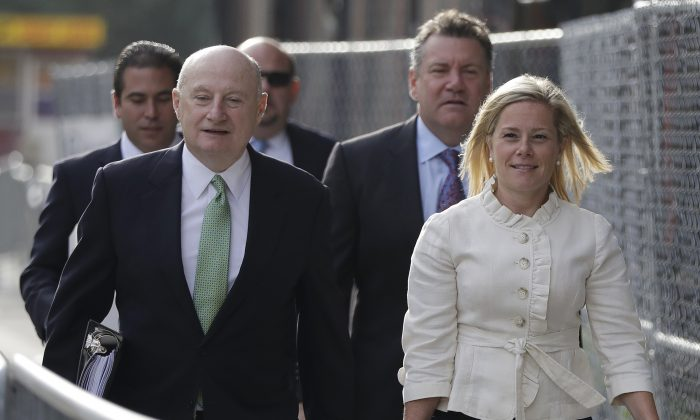 New Jersey Gov. Chris Christie's former Deputy Chief of Staff Bridget Anne Kelly, right, arrives at Martin Luther King, Jr., Federal Court for a hearing, Tuesday, Sept. 20, 2016, in Newark, N.J. Three years after gridlock paralyzed a New Jersey town next to the George Washington Bridge for days, two former allies of Christie, Bill Baroni and Kelly, are being tried. (AP Photo/Julio Cortez)