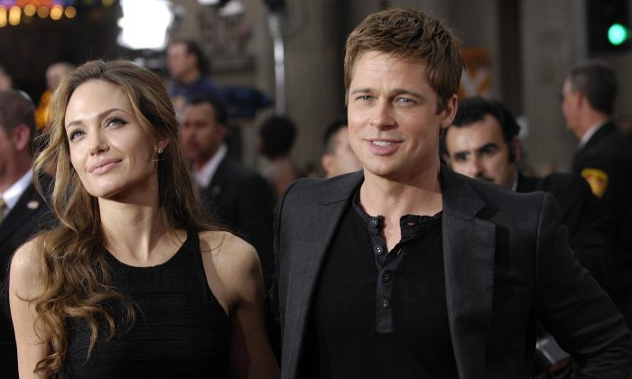 "In this  June 5, 2007 file photo, Brad Pitt, right, a cast member in the film ""Ocean's Thirteen,"" arrives with Angelina Jolie at the premiere of the film at Grauman's Chinese Theatre in Los Angeles. (AP Photo/Chris Pizzello, File)"