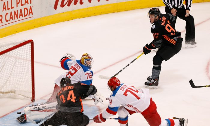 Auston Matthews scores a first period goal after a pass by Connor McDavid during the World Cup of Hockey at the Air Canada Centre on Sept. 19, 2016 in Toronto. (Gregory Shamus/Getty Images)