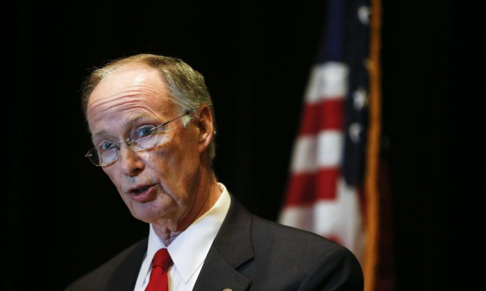 "Alabama Gov. Robert Bentley speaks to the media during a news conference, Monday, Sept. 19, 2016, in Hoover, Ala. Bentley issued a state of emergency in Alabama after a pipeline spill near Helena, Ala. Gas prices spiked and drivers found ""out of service"" bags covering pumps as the gas shortage in the South rolled into the work week, raising fears that the disruptions could become more widespread. (AP Photo/Brynn Anderson)"