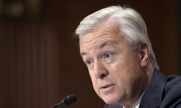 """FILE - In this Tuesday, Sept. 20, 2016 file photo, Wells Fargo Chief Executive Officer John Stumpf testifies on Capitol Hill in Washington, before the Senate Banking Committee. Facing bipartisan outrage from a Senate panel over accusations of employee misconduct, Stumpf appeared taken aback by the intensity of the verbal lashing. He bristled at assertions that the alleged opening of millions of customer accounts without their permission was a """"scam."""" (AP Photo/Susan Walsh, File)"""