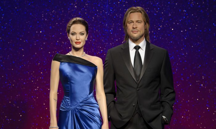 Wax figures resembling married actors Angelina Jolie Pitt (L) and Brad Pitt on display at a Madame Tussauds wax museum. (Madame Tussauds via AP)