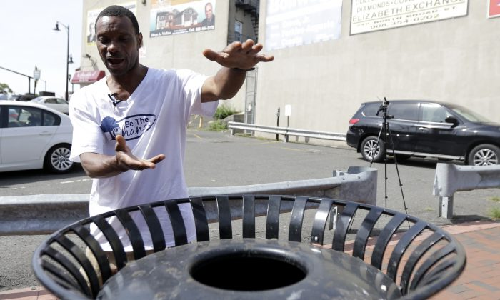 Lee Parker explains to reporters how he found a bomb near a trash can, Wednesday, Sept. 21, 2016, in Elizabeth, N.J. Authorities say Parker and a friend contacted police after finding the bag near the Elizabeth train station Sunday night. Federal investigators say the bag was left by New York-region bombing suspect Ahmad Khan Rahami.  (AP Photo/Julio Cortez)