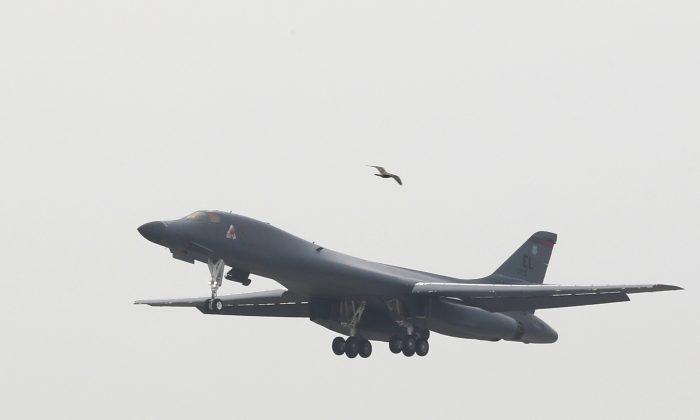 A U.S. Air Force B-1B bomber from Andersen Air Force Base, Guam, flies over Osan Air Base in Pyeongtaek, South Korea, Wednesday, Sept. 21, 2016. (Seo Myung-gon/Yonhap via AP) KOREA OUT