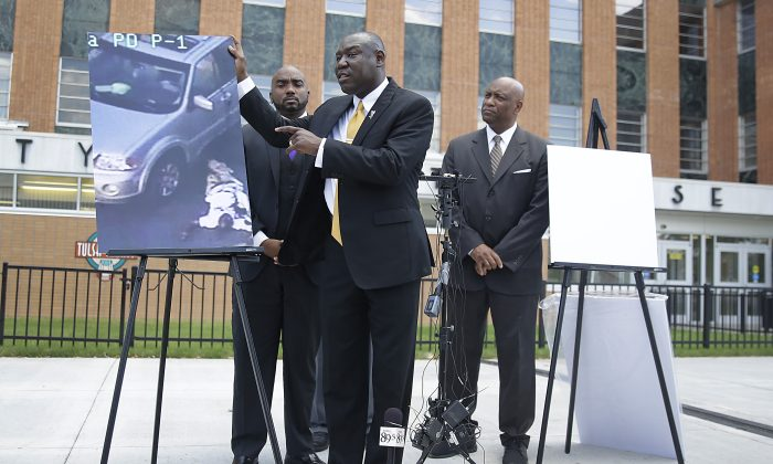 Attorney Benjamin Crump, center, one of the attorneys for Crutcher's family, speaks about Terence Crutcher during a news conference about the shooting death of Crutcher Tuesday, Sept. 20, 2016 in Tulsa, Okla. Crutcher, was shot by a Tulsa Police officer on Friday night. Also pictured are attorneys David Riggs, left, Damario Solomon-Simmons and Melvin C. Hall. (Mike Simons/Tulsa World via AP)