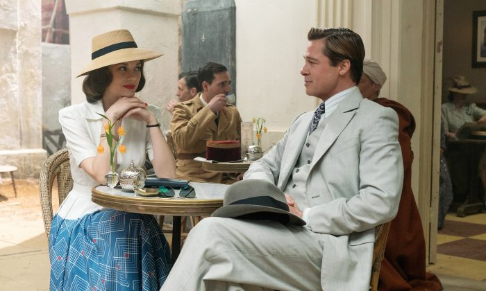"""Marion Cotillard (L) and Brad Pitt in a scene from, """"Allied,"""" in theaters on November 23. (Daniel Smith/Paramount Pictures via AP)"""