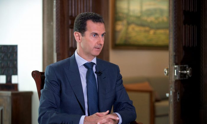 Syrian President Bashar Assad speaks to The Associated Press at the presidential palace in Damascus, Syria, on  Sept. 21, 2016. (Syrian Presidency via AP)