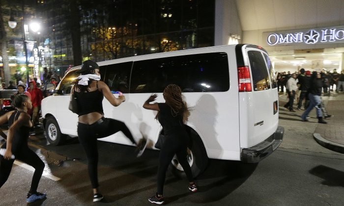 Demonstrators protest Tuesday's fatal police shooting of Keith Lamont Scott in Charlotte, N.C. on Wednesday, Sept. 21, 2016. (AP Photo/Chuck Burton)