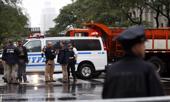 Police and security agents man a vehicle barricade across 42nd Street at Second Avenue near United Nations headquarters, Monday, Sept. 19, 2016, in New York. (AP Photo/Jason DeCrow)
