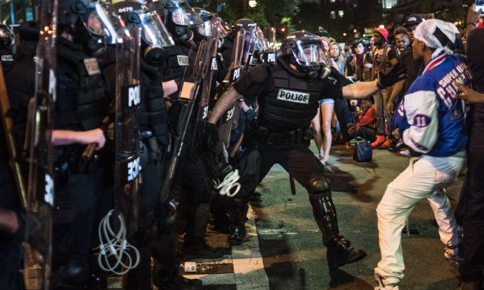 A police officer tries to grab a protester in downtown Charlotte, NC., on Sept. 21. (Sean Rayford/Getty Images)
