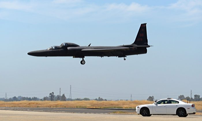 This June 16, 2015, photo released by DVIDS/U.S. Air Force shows a mobile chase car pursuing a U-2 Dragon Lady as the aircraft prepares to land at Beale Air Force Base, Calif. Mobile chase cars guide the aircraft during takeoffs and landings. One American pilot was killed and another injured when they ejected from a U-2 spy plane shortly before it crashed in Northern California on Tuesday, Sept. 20, 2016 the U.S. Air Force said.(Airman 1st Class Ramon A. Adelan/Released U.S. Air Force via AP)