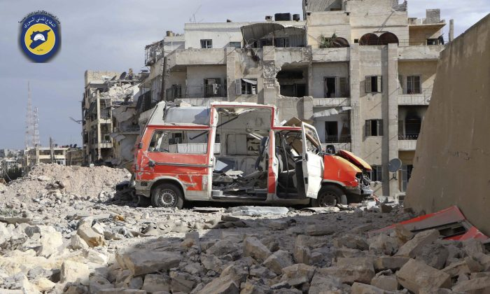 In this photo provided by the Syrian Civil Defense group known as the White Helmets, a destroyed ambulance is seen outside the Syrian Civil Defense main center after airstrikes in Ansari neighborhood in the rebel-held part of eastern Aleppo, Syria, Friday, Sept. 23, 2016. A Syria monitoring group and a rescue worker say an intense air bombing campaign has targeted several neighborhoods in rebel-held part of Aleppo city, including centers of the award-winning volunteer civil defense group known as the White Helmets. (Syrian Civil Defense White Helmets via AP)