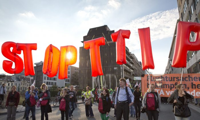 Protestors hold an Anti-TTIP inflatable banner during a demonstration against international trade agreements in Brussels on Tuesday, Sept. 20, 2016. A demonstration was held in the European Quarter on Tuesday to protest against trade and investment deals such as TTIP and CETA. (AP Photo/Virginia Mayo)