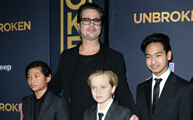 Actor Brad Pitt and children Pax Jolie-Pitt (L), Shiloh Jolie-Pitt (C) and Maddox Jolie-Pitt arrive for the U.S. premiere of Universal Pictures 'Unbroken,' December 15, 2014 at the Dolby Theatre in Hollywood, California. Brad The Los Angeles County Department of Children and Family Services has reportedly extended its investigation of child abuse allegations against Pitt. (ROBYN BECK/AFP/Getty Images)