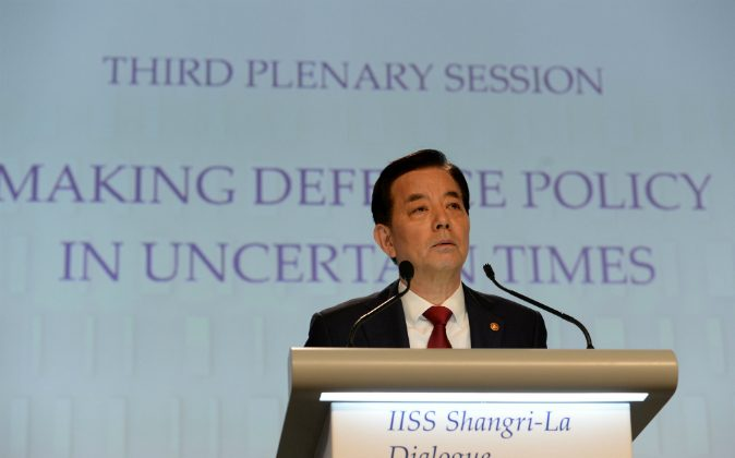 South Korea's Minister of National Defence Minkoo Han delivers his speech during a plenary session at the 15th International Institute for Strategic Studies (IISS) Shangri-La Dialogue in Singapore on June 4, 2016. Han said South Korea will assassinate Kim Jong Un if a nuclear threat arise on Sept. 21. (ROSLAN RAHMAN/AFP/Getty Images)