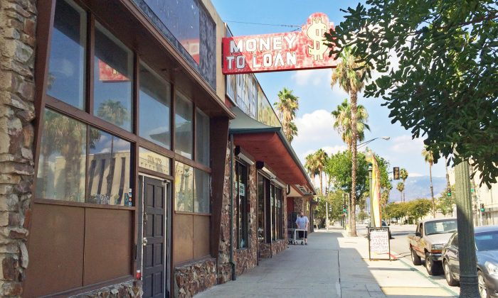 This photo shows a street in downtown San Bernardino, Calif., which has many empty storefronts on Sept, 21, 2016. (AP Photo/Amy Taxin)
