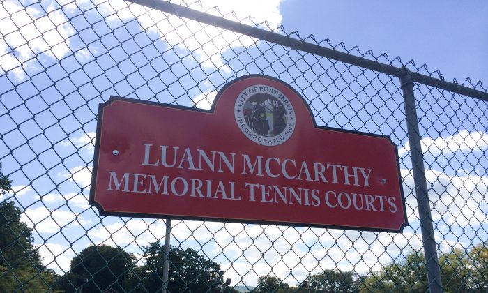 The sign on the fence of the Port Jervis Church Street Park tennis courts on Sept. 24, 2016. The courts were named after a teacher, tennis coach, and Recreation Commission member who lost her battle with cancer in 2015. (Holly Kellum/Epoch Times)