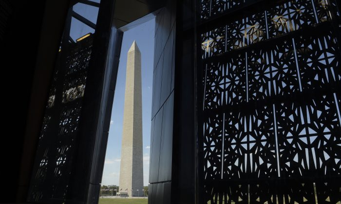 The Washington Monument is framed by a window at the National Museum of African American History and Culture in Washington on Sept. 14, 2016. (AP Photo/Susan Walsh)