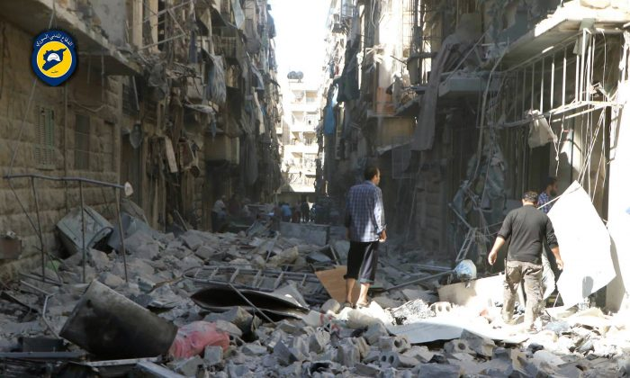 Syrians inspect damaged buildings after airstrikes hit in Aleppo, Syria, on Sept. 24, 2016. (Syrian Civil Defense White Helmets via AP)