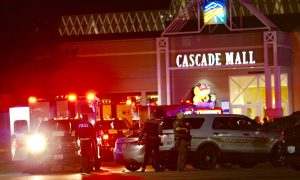 City 'Changed Forever' as Authorities Hunt Mall Gunman