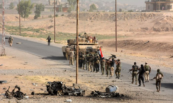 Iraqi troops deploy in the town of Sharqat, 260 kilometers (160 miles) northwest of Baghdad and around 80 kilometres (50 miles) south of Mosul, on Sept. 22, 2016 as Iraq announced that its forces have recaptured the northern town from the Islamic State in an operation launched ahead of a push for the city of Mosul. (Mahmud Saleh/AFP/Getty Images)