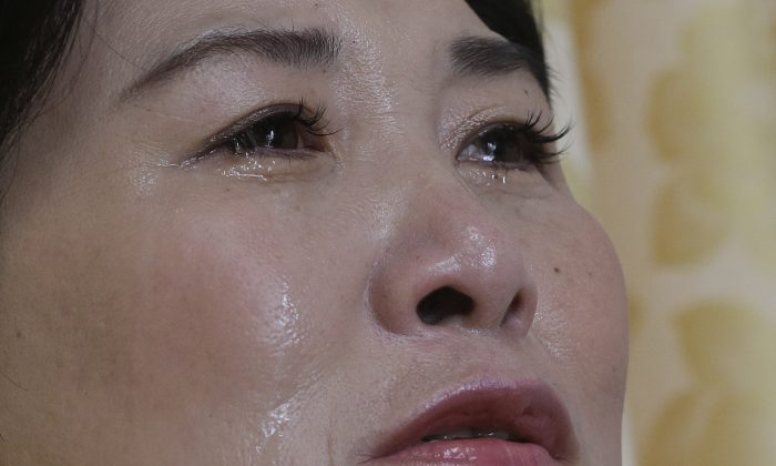North Korean defector Kim Jungah cries during an interview at her house in Gunpo, South Korea, on Sept. 4, 2016. (AP Photo/Ahn Young-joon)