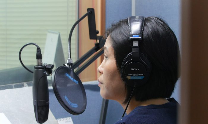 North Korean defector Park Kyung-hwa who works for a Seoul-based shortwave radio station targeting audience in North Korea, demonstrates how she records her broadcast at a church in Seoul, South Korea, on Aug. 25, 2016. Park, who fled the North in 2000 before being sold to a Chinese man, said she saw brokers grope other trafficked women many times. She said brokers kicked and beat her with wooden clubs for about 20 minutes when her first attempt to escape failed. (AP Photo/Jungho Choi)