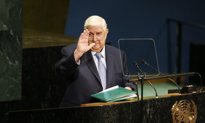 Syria's Foreign Minister Walid al-Moallem waves after addressing the 71st session of the United Nations General Assembly at U.N. headquarters on Sept. 24, 2016. (AP Photo/Jason DeCrow)