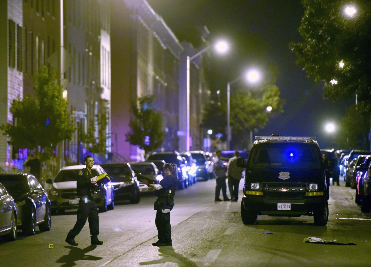 Baltimore police work at a scene where multiple people were shot in Baltimore on Sept. 24, 2016. Police said that none of the shootings were fatal. (AP Photo/Steve Ruark)