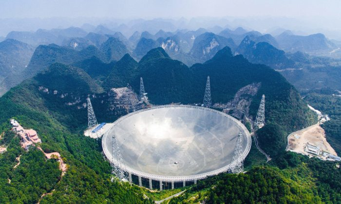 An aerial view shows the Five-hundred-meter Aperture Spherical Telescope (FAST) in the remote Pingtang county in southwest China's Guizhou Province on Sept. 24, 2016. China has begun operating the world's largest radio telescope to help search for extraterrestrial life. (Liu Xu/Xinhua via AP)