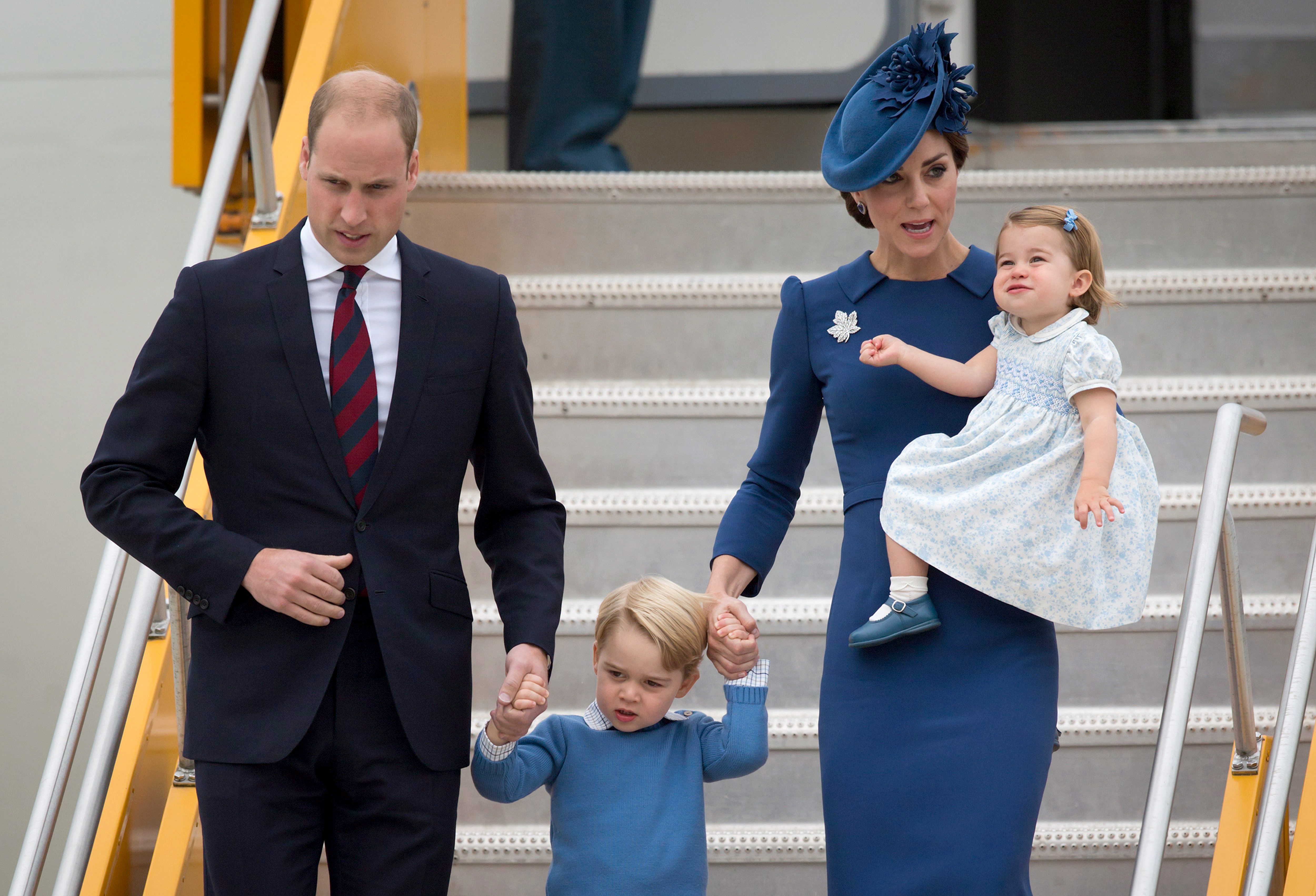 Britain's Prince William and his wife Kate, the Duke and Duchess of Cambridge, along with their children Prince George and Princess Charlotte arrive in Victoria, British Columbia, Saturday, Sept. 24, 2016. (Darryl Dyck/The Canadian Press via AP)
