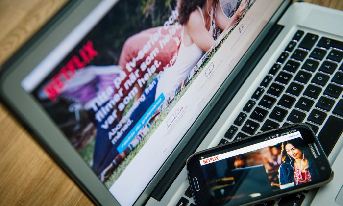 Netflix streaming video is shown on a laptop and smartphone in a file photo. (Jonathan Nackstrand/AFP/Getty Images)