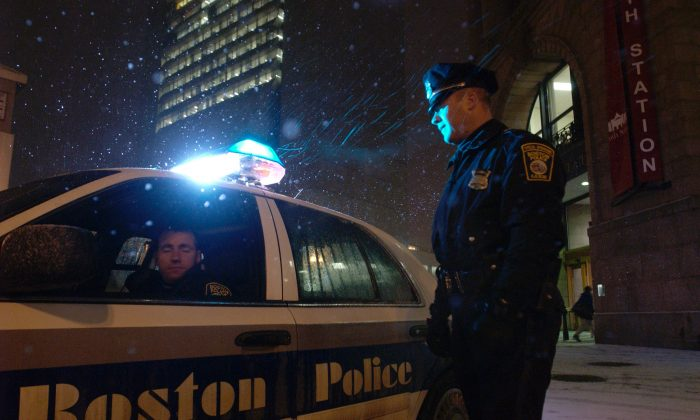 Boston Police officers patrol outside the South Station train station in Boston, Mass., on Jan. 19, 2005. (Jodi Hilton/Getty Images)