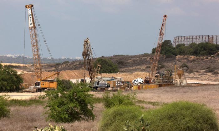 Cranes and other machineries are seen at the Israeli side of the border with Gaza Strip, on Sept. 8, 2016. Israel is building an underground wall around Gaza to stop Hamas attack tunnels, Israeli media and a local council official said. (Menahem Kahana/AFP/Getty Images)