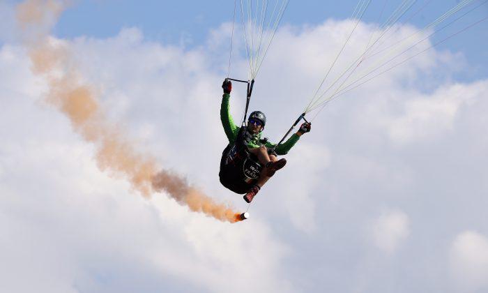 Francois Ragolski, 2016 World Champion aerobatic paragliding performs aerobatic flight during the 43st Icare Cup paragliding festival in Saint Hilaire du Touvet, French Alps on Sept. 24, 2016. (AP Photo/Francois Mori)