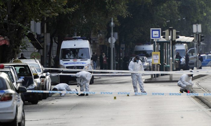 Police forensic experts examine the scene in central Budapest, Hungary on Sept. 25, 2016. (Peter Lakatos/MTI via AP)
