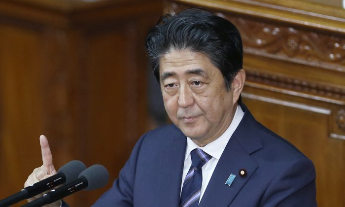 Japan's Prime Minister Shinzo Abe delivers his policy speech during a Diet session at the lower house of Parliament in Tokyo, Monday, Sept. 26, 2016. (AP Photo/Shizuo Kambayashi)