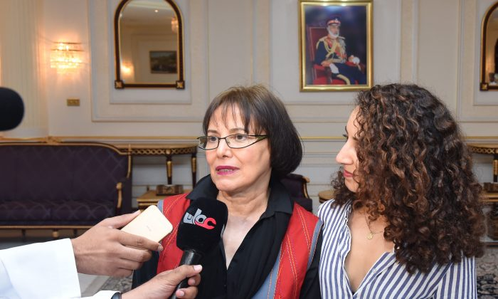 Retired Iranian-Canadian professor Homa Hoodfar (R) speaking to the media in Muscat airport, Oman, after being released by Iranian authorities on Sept. 26, 2016. (Oman News Agency via AP)