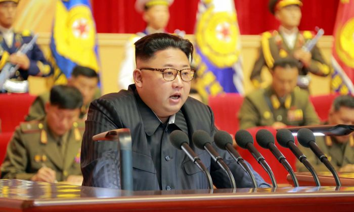 An undated photo of North Korean leader Kim Jong-Un (C) delivering a speech at the 3rd Meeting of KPA Activists in O Jung Hup-led 7th Regiment Title Movement at the April 25 House of Culture in Pyongyang. (KCNA/AFP/Getty Images)
