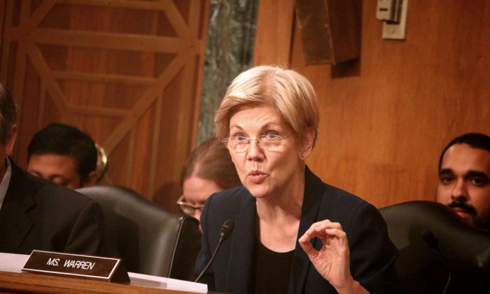 Senator Elizabeth Warren (D-Mass.) lambasts the CEO of Wells Fargo & Co. at a hearing of the Senate Banking Committee, Sep. 20. (Gary Feuerberg/Epoch Times)