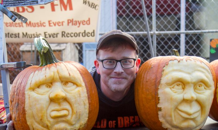 Robert McDonough with a couple of his pumkin creations at the 24th Annual Fall Foliage Festival in Port Jervis on Sept. 25, 2016. (Colin Fredericson/Epoch Times)