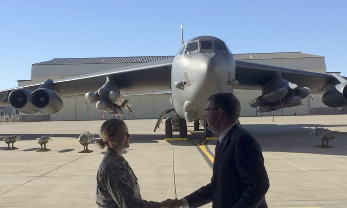 Defense Secretary Ash Carter greets airmen at Minot Air Force Base, N.D., Monday, Sept. 26, 2016, after giving a speech on nuclear weapons. Carter says the Pentagon is committed to correcting what he calls decades of shortchanging its nuclear forces. Carter spoke Monday at a nuclear missile and bomber base in Minot. He says $108 billion is earmarked for sustaining and improving the forces over the next five years. (AP Photo/Robert Burns)