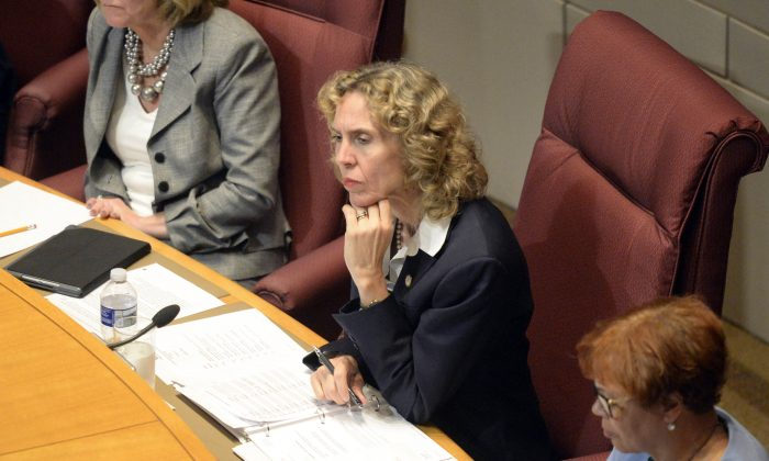 Charlotte Mayor Jennifer Roberts listens to a speaker at the Charlotte City Council meeting during time for public comments, mainly concerning last week's shooting of Keith Lamont Scott, at the Charlotte Mecklenburg Government Center, Monday, Sept. 26, 2016. (David T. Foster III/The Charlotte Observer via AP)