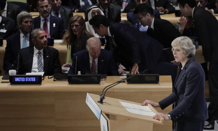 """File-This Sept. 20, 2016, file photo shows British Prime Minister Theresa May, right, speaking at a Leader's Refugee Summit as U.S. President Barack Obama left, and Vice President Joe Biden, center, listen during the 71st session of the United Nations General Assembly, at U.N. headquarters. As for the """"buzz"""" in U.N. corridors, it was two newcomers making their debuts on the international stage that captured the most attention: British Prime Minister Theresa May and Canadian Prime Minister Justin Trudeau. May assured the General Assembly that Britain will remain a global power and continue playing a role in trying to resolve the many challenges in the world despite its decision to leave the European Union. (AP Photo/Julie Jacobson, File)"""