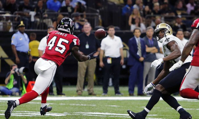 Atlanta Falcons outside linebacker Deion Jones (45) intercepts a pass from New Orleans Saints quarterback Drew Brees, not pictured, and returns it for a touchdown, in the second half of an NFL football game in New Orleans on Sept. 26, 2016. (AP Photo/Butch Dill)