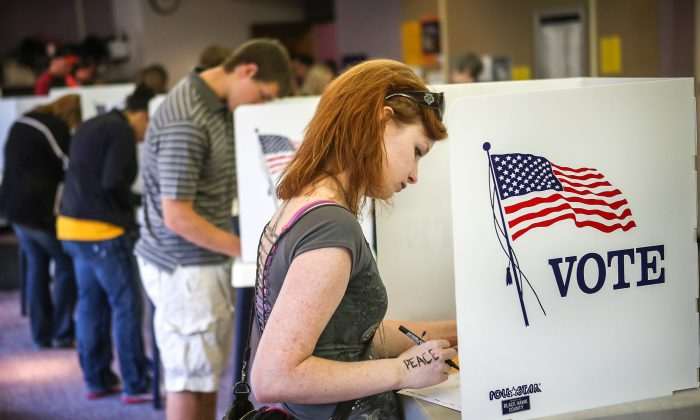 A Student votes on the campus of the University of Northern Iowa (UNI) in Cedar Falls, Iowa, during the 2012 election. (Scott Olson/Getty Images)