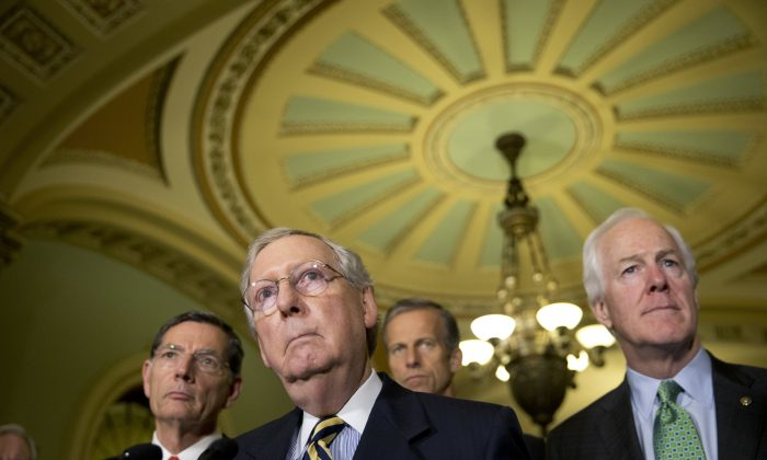 Senate Majority Leader Mitch McConnell of Ky., accompanied by (L-R) Sen. John Barrasso, R-Wyo., Sen. John Thune, R-S.D., and Senate Majority Whip John Cornyn of Texas, listen on Capitol Hill in Washington. (AP Photo/Alex Brandon, File)